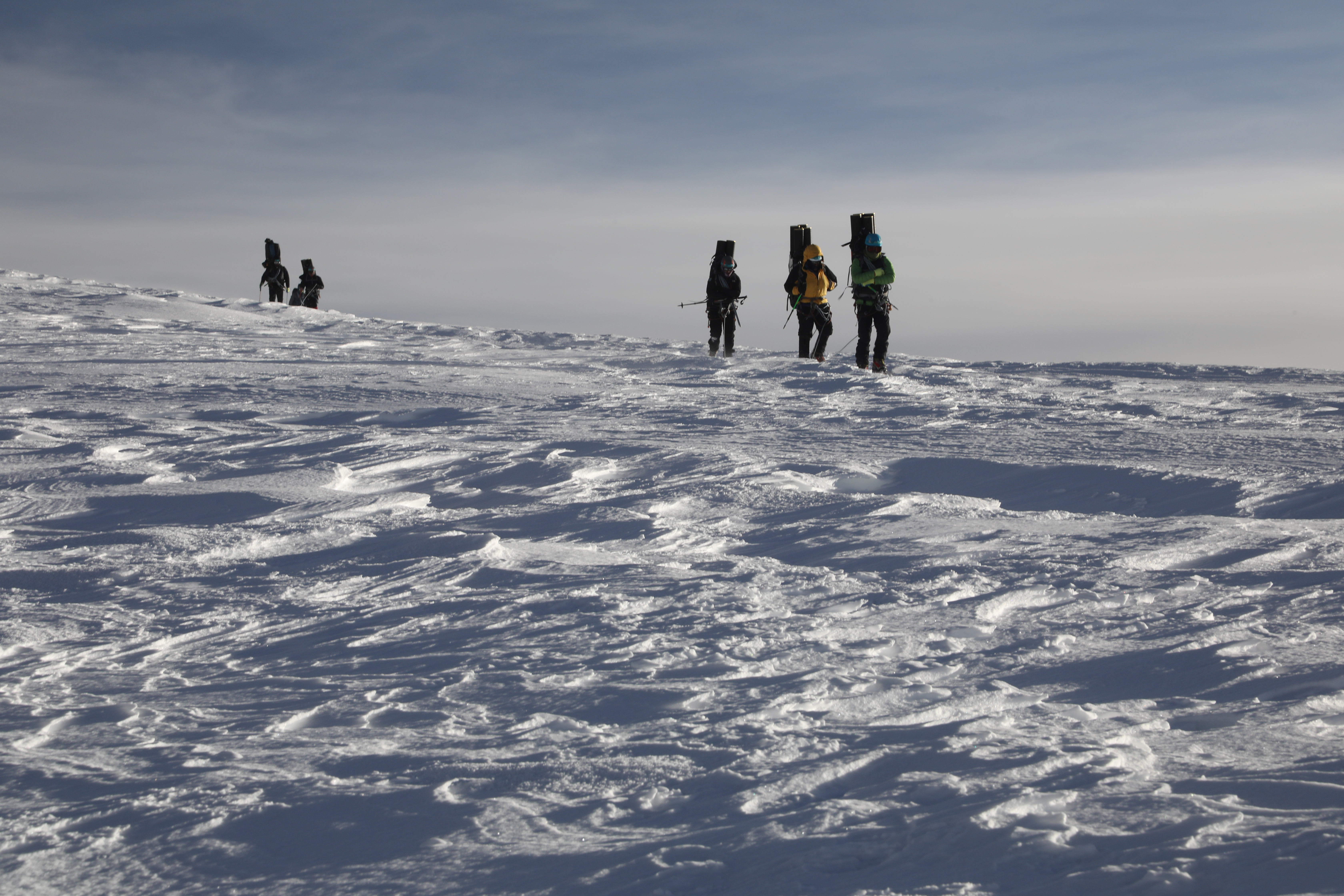 Bolivians guides arriving at the summit camp