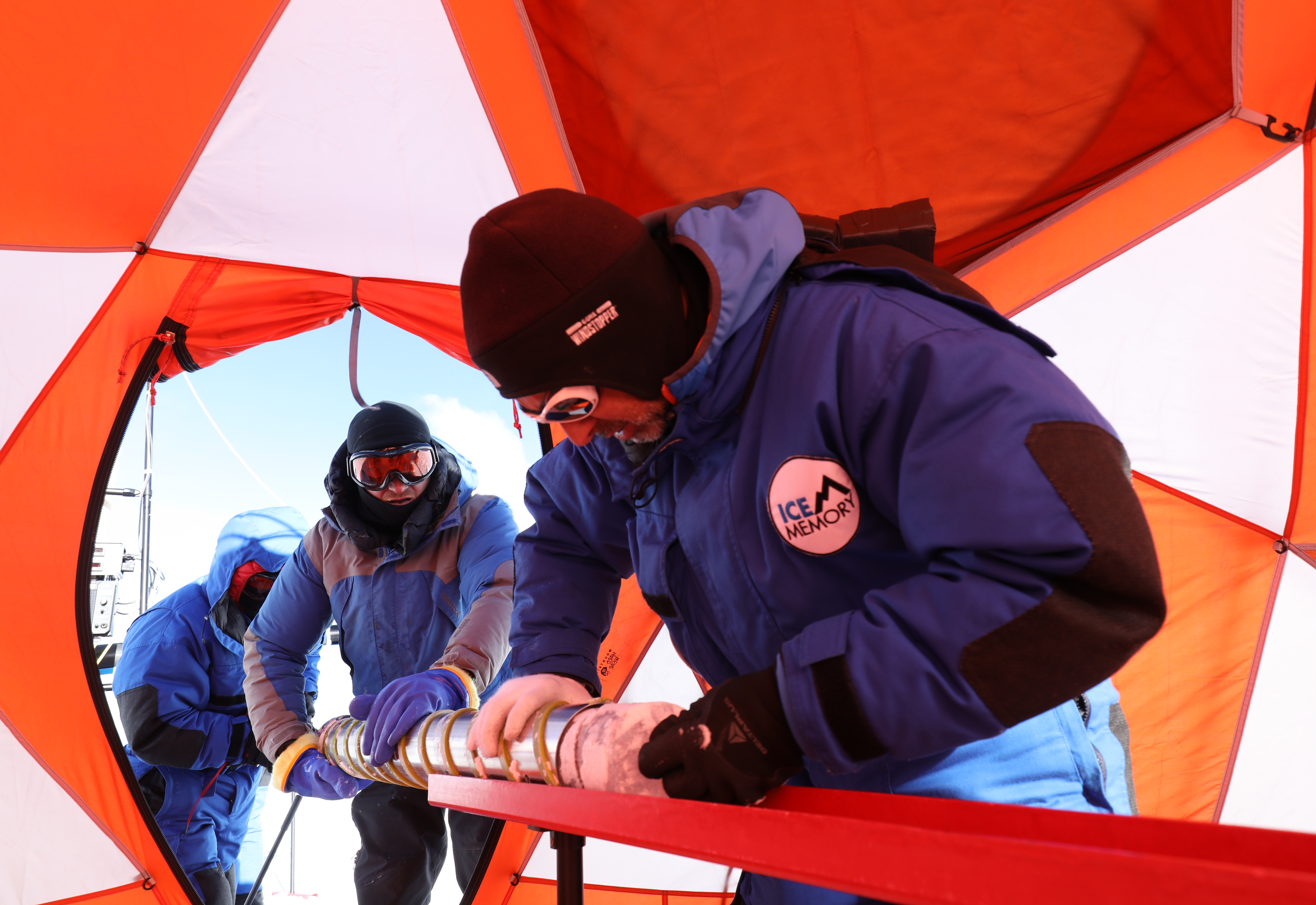 scientists drilling at the summit camp